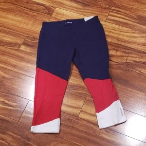 Red, white, and blue Reebok capris.
